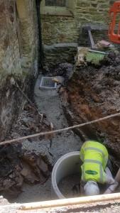 New manholes behind the vestry